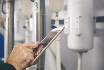 Senior man in a boiler room working. Shallow DOF. Developed from RAW; retouched with special care and attention; Small amount of grain added for best final impression. 16 bit Adobe RGB color profile.