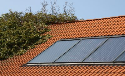 Solar thermal system on an overgrown roof
